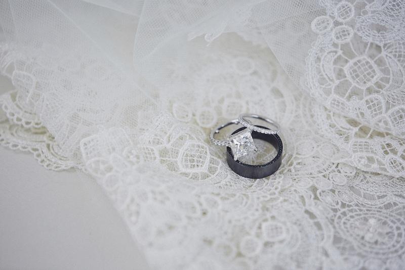 Black diamond wedding band and princess-cut diamond