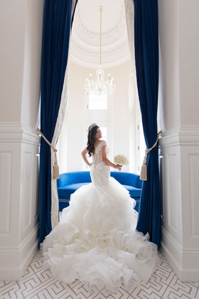 Bride in tiara long hair matthew christopher wedding dress ruffle skirt mermaid illusion back