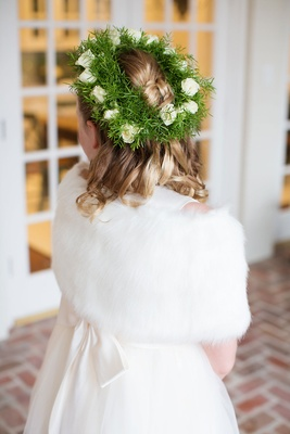Flower girl with greenery and white rose flower crown white fur wrap ivory dress curls blonde