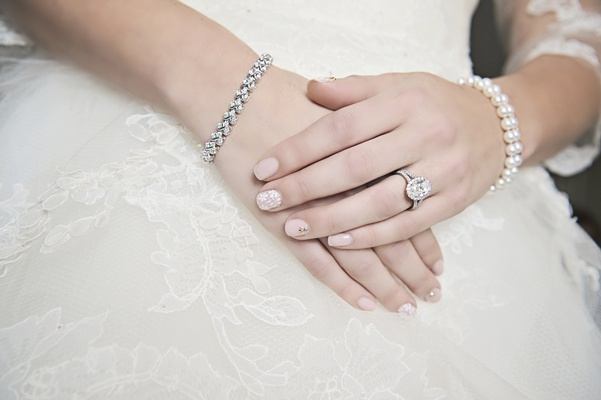 bridal manicure with lace accent and jeweled accent, nude blush polish