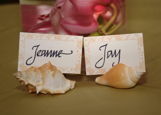 Bride and groom seating card in seashells