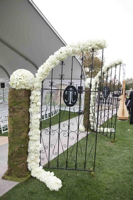 Wedding monogram on gate and harp