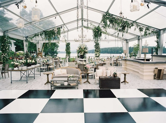 Black and white square checker dance floor clear tent wedding furniture food stations light bulbs