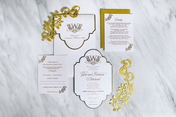white gold wedding invitation on marble table gold laser cut details die cut invite monogram
