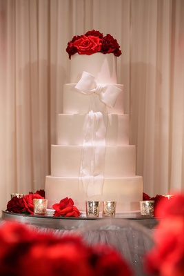 wedding cake five layers of fondant round tier white ribbon red rose cake topper mirror table