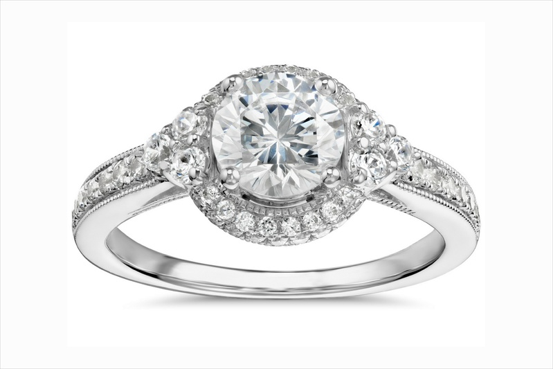 Monique Lhuillier diamond engagement ring with halo and pave band