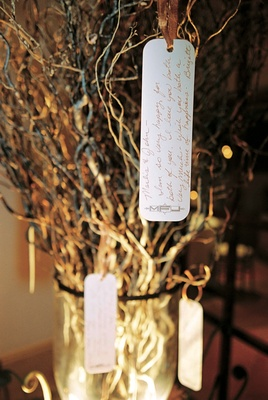 Rectangular cards tied with golden ribbon on branches