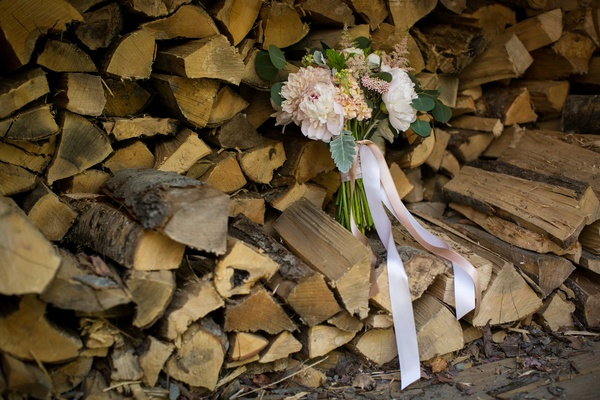 blush ivory bouquet ribbons firewood pink white rustic wedding