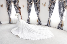 bride at legacy castle with royal drapery in eve of milady strapless gown with long train