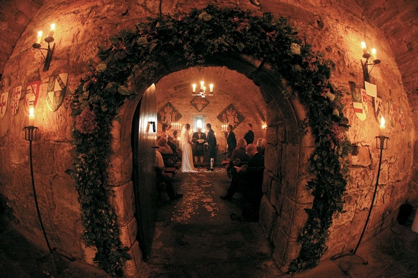 Dark castle wedding ceremony decorations in cave-like room