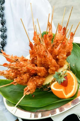 Shellfish on a stick in pineapple