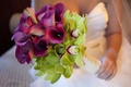 Purple calla lily and green orchid wedding bouquet