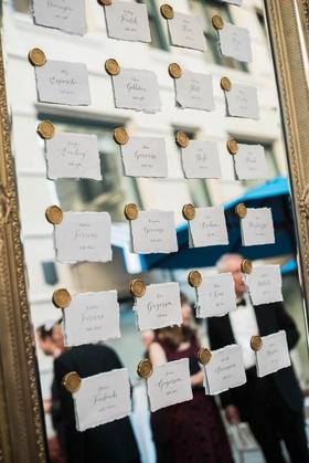 paper escort cards stuck to mirrors via gold wax seals