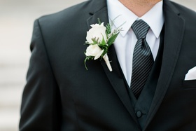 groom boutonniere with two white roses, greenery accents