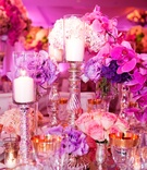 Fuchsia orchids and purple flower wedding centerpiece