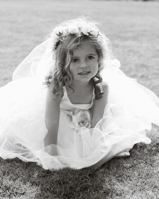 Black and white photo of young girl in grass