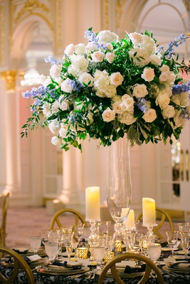 wedding reception centerpiece glass vase greenery white rose hydrangea blue flowers candles