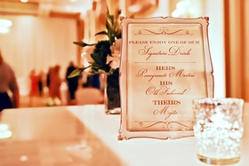 Drinks menu in elegant gold-rimmed frame