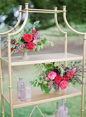 gold bookshelf colorful flowers vases california boho chic wedding styled shoot details unique