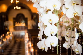 Close-up of orchid and jewel floral arrangements at Grand Del Mar wedding ceremony