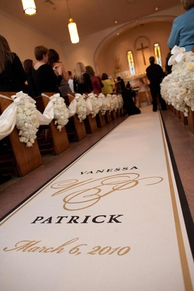 Wedding ceremony aisle runner with couple's name, monogram, and date in gold and black colors