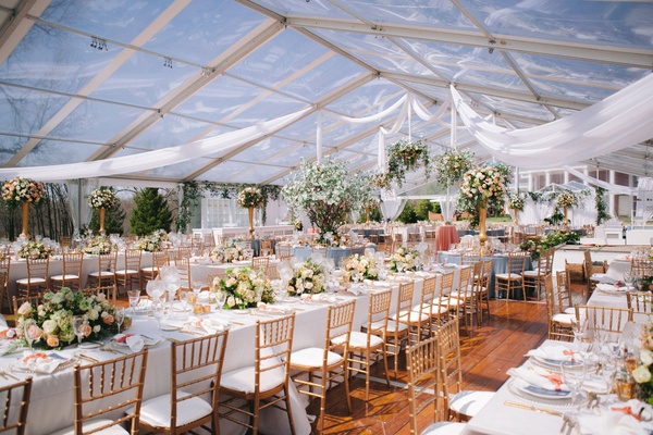 wedding reception st louis clear tent greenhouse drapery long table trees low high centerpieces
