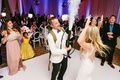 groom with carbon dioxide tank at wedding reception to fill dance floor with fog