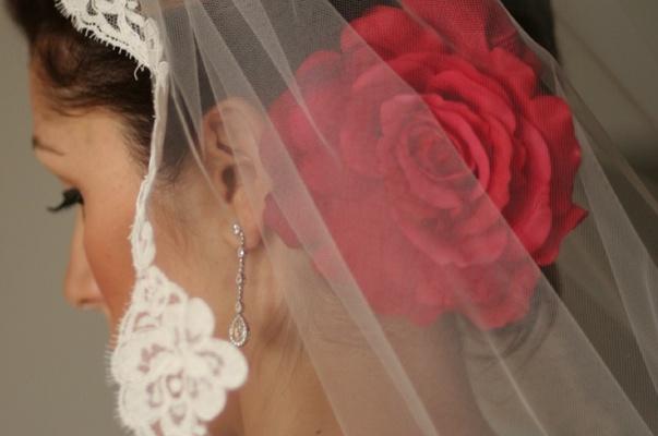 Bride's mantilla veil and red flower hair accessories