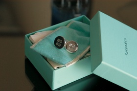 tiffany and co blue box open to display silver and black cuff links