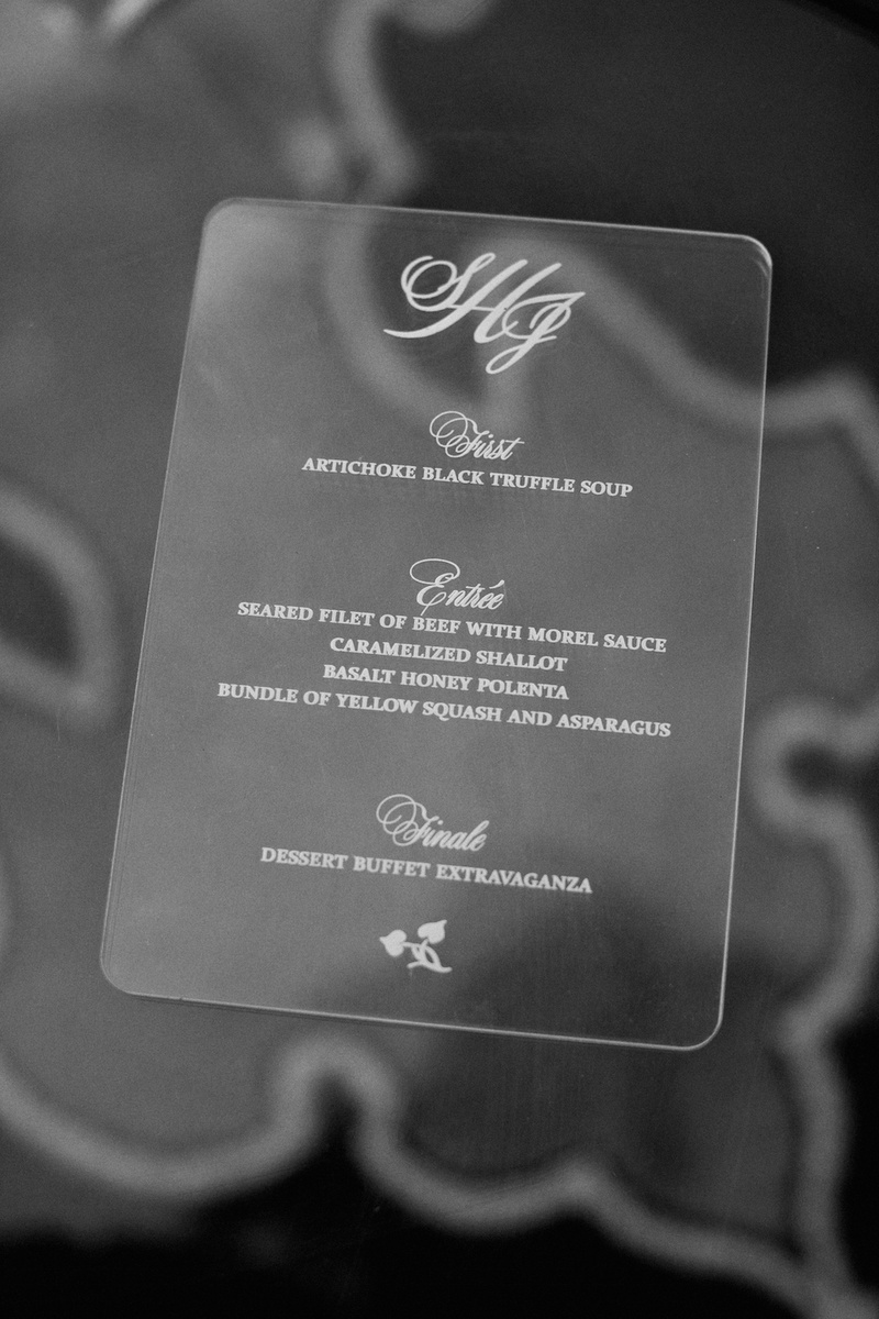Black and white photo of etched Lucite menu