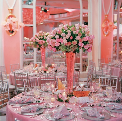 Unique tall vase on pink tablecloth
