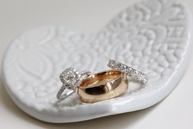 Bridal jewelry wedding ring and engagement ring with men's band in heart shaped white dish holder