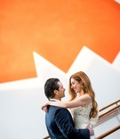 Bride with long beautiful red hair and groom with slicked back hair wedding portrait