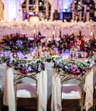 wedding reception ballroom chameleon chair collection gold bride groom chairs drapery greenery