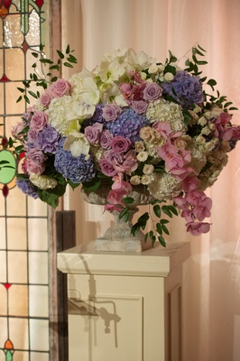 white purple pink blue flower arrangement roses hydrangeas and orchids