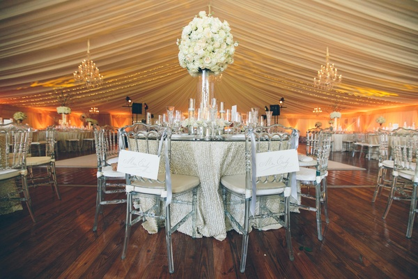 Sequined tablecloths and chandelier lighting