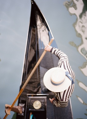 Aerial view of gondola driver gondolier striped shirt and hat