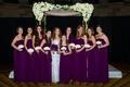 Bridesmaids and junior bridesmaids in long bridesmaid dresses in deep purple color