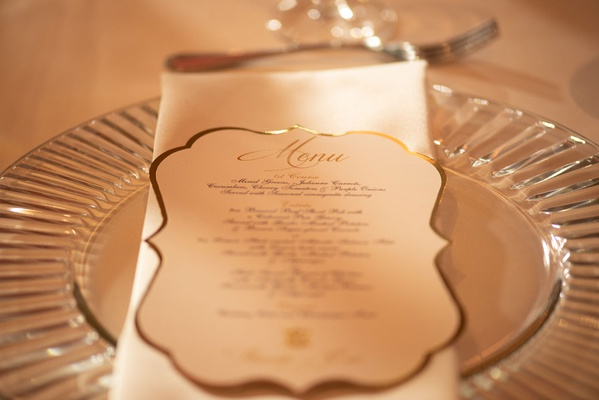 wedding reception clear glass charger plate white napkin white gold menu card die cut gold border