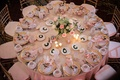 reception table with blush linens and gold-rimmed chargers