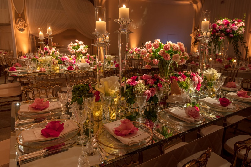 Rectangular wedding table with crystal candleholders, pink flowers in mirror boxes and vases pink