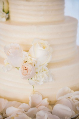 White textured wedding cake with ivory roses, hydrangeas from SusieCakes