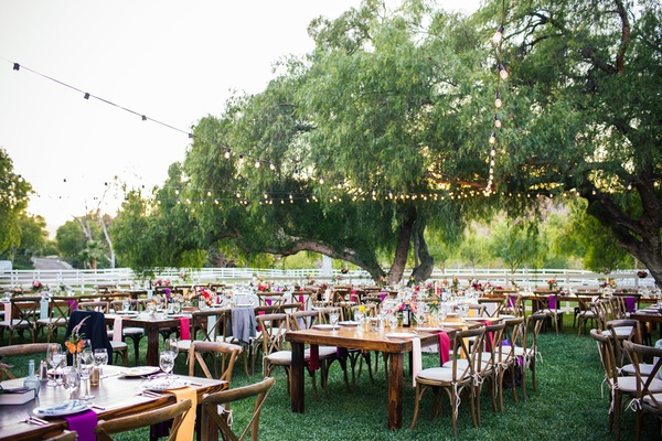 Outdoor bohemian wedding reception at Hummingbird Nest Ranch, CA