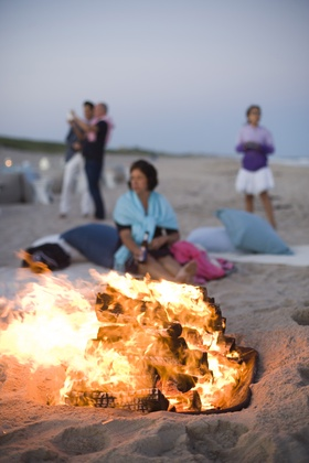 Oceanfront bonfire on sand