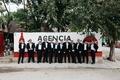 Groom and groomsmen in black tuxedos in Playa del Carmen, Mexico