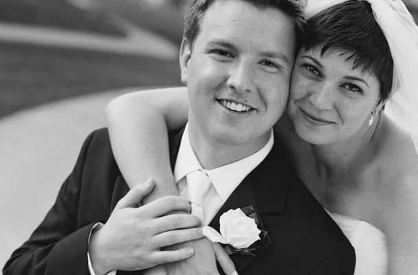 Black and white photo of bride with short hair and groom
