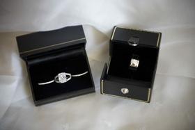 Bride's wedding rings in box and groom's band in box