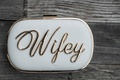 "small bridal clutch in white and gold with ""wifey"" in metal"