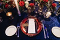 winter wedding tablescape decorations blue linens with scarlet rose flower arrangement centerpieces