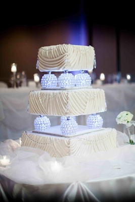 Three layer cake with glowing globes and ruched frosting